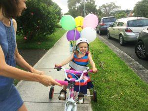 Annabelle on her Freedom Wheels bike